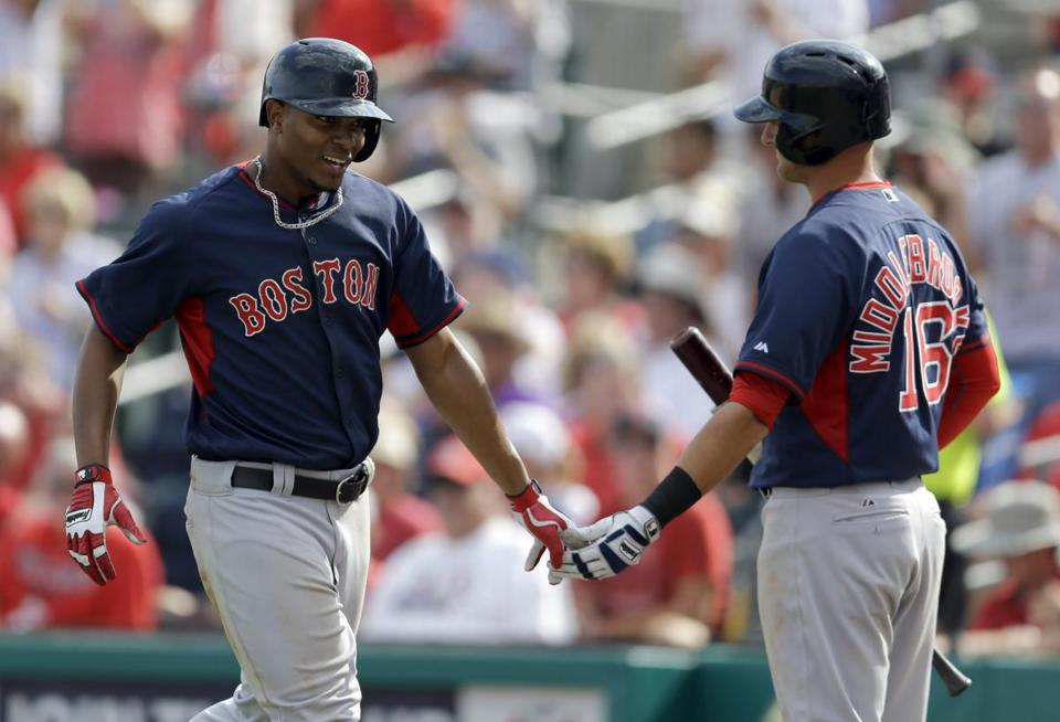 Boston Red Sox's Xander Bogaerts, left, is congratulated by teammate Will Middlebrooks after hitting a two-run home run during the sixth inning of an exhibition spring training baseball game against the St. Louis Cardinals Wednesday, March 5, 2014, in Jupiter, Fla. (AP Photo/Jeff Roberson)